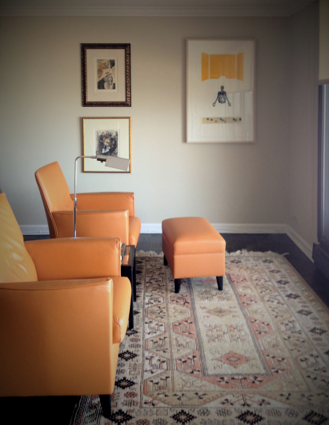 Combining old and new. This seating space was created to look out over Lake Michigan. We refinished the floors, hung existing artwork, and specified new furniture and lighting.