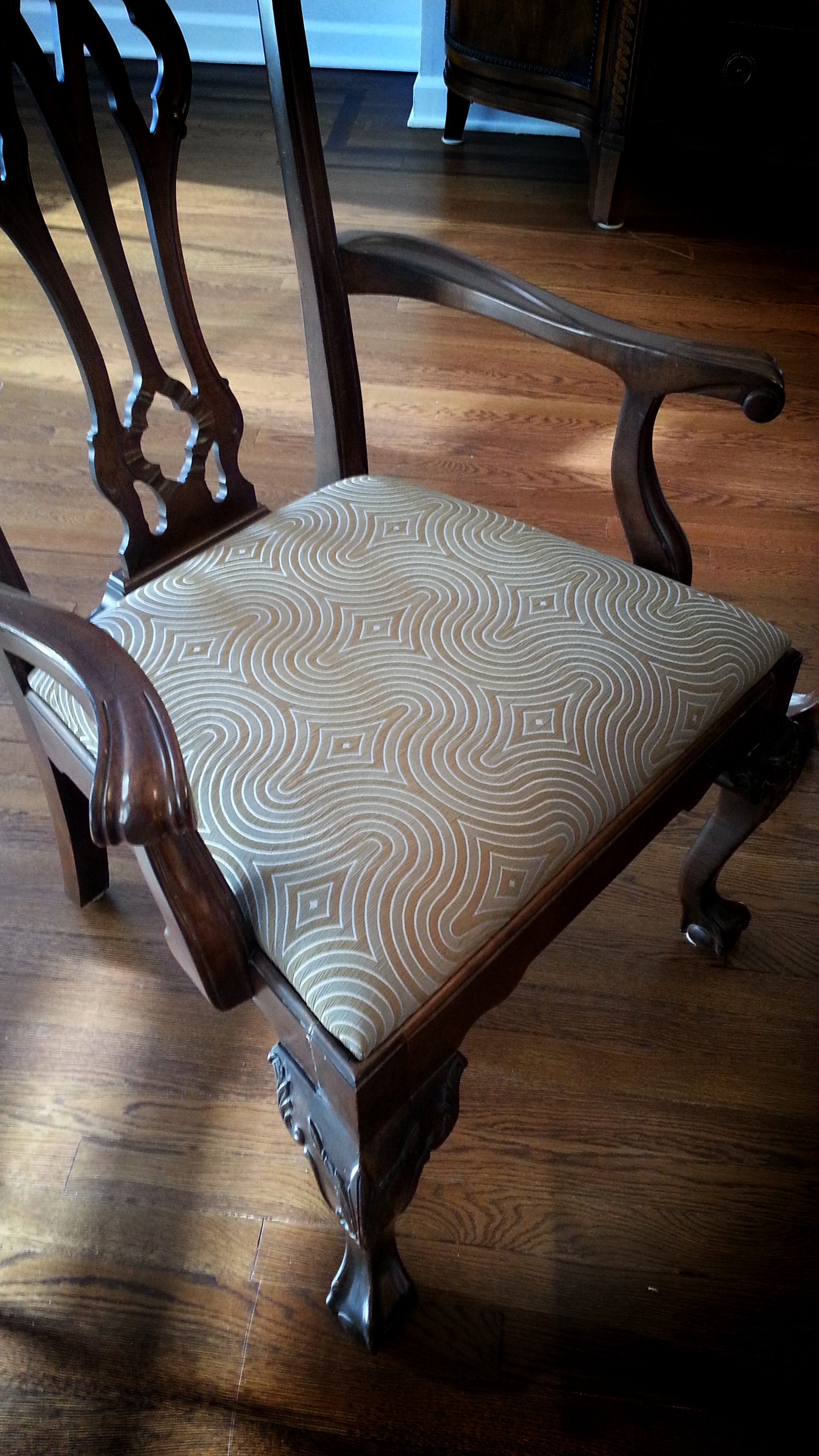 We recovered these antique chairs with a fabric that echoes the chair's curves and style.