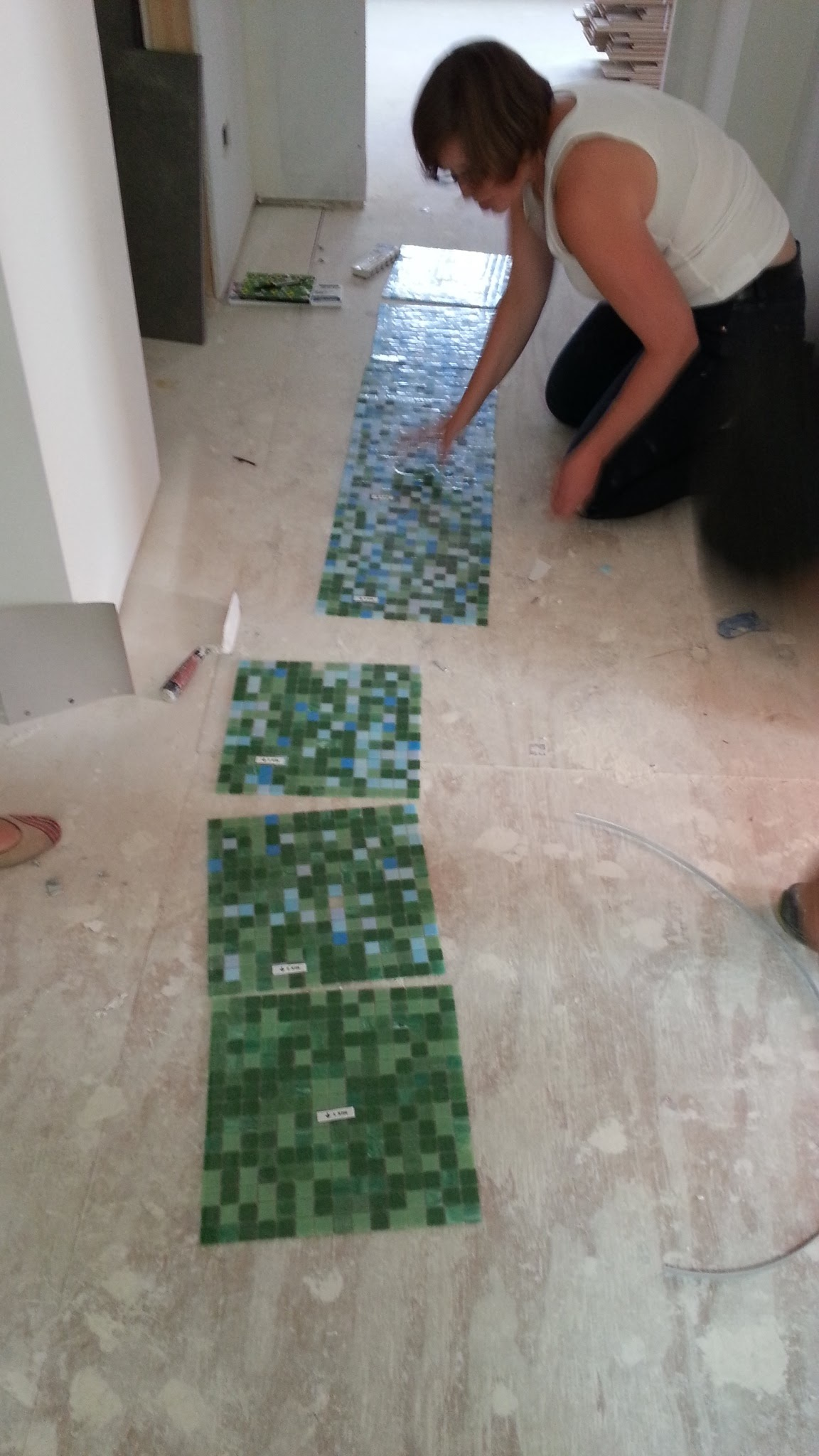 Laying out the hall bath floor.