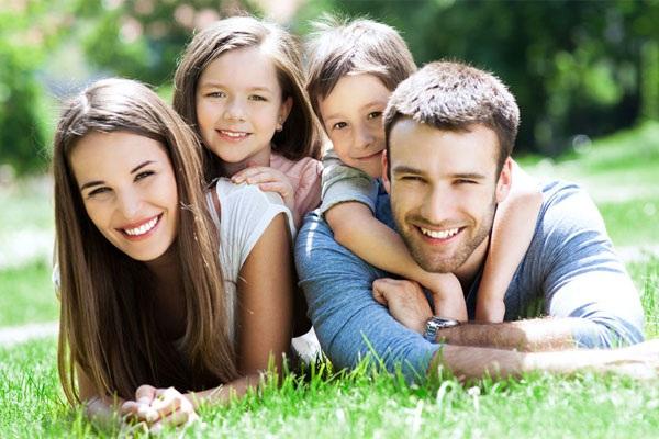 happy+family+smiling+on+grass.jpg