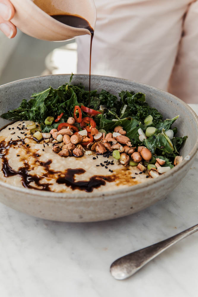 Savoury Indonesian Porridge with Garlic Sautéed Kale, Chilli, Soy Sauce, and Toasted Peanuts