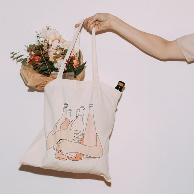 "New addition to the shop (link in bio)! This lightweight carry-all tote bag was originally designed as a gift bag for my friend's bachelorette party in the spirit of #roseallday. Now you can properly showcase your love for rosé while running errands, grocery shopping, or going to the library. It's cute, practical, a little sassy, and can handle all your shit–just like the ladies I originally designed it for. More skin tones coming soon!  Shoutout to @sylviethecamera for the most gorgeous photos and @putnamflowers for the flower arrangement of my dreams! •Dimensions: 15.75""l x 15.25""w •100% cotton •Cotton handles with stress point reinforced stitching"