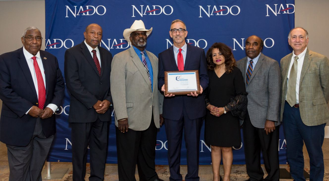 LSCOG Board members accepted 2 NADO awards at the 2018 NADO conference in Charlotte, NC. From left to right: William Price, Johnny Ravenell, Larry Haynes (COG Board Chairman), Doug Elliott (NADO President), Lessie Price, William Robinson and Dr. William Molnar (COG Executive Director).