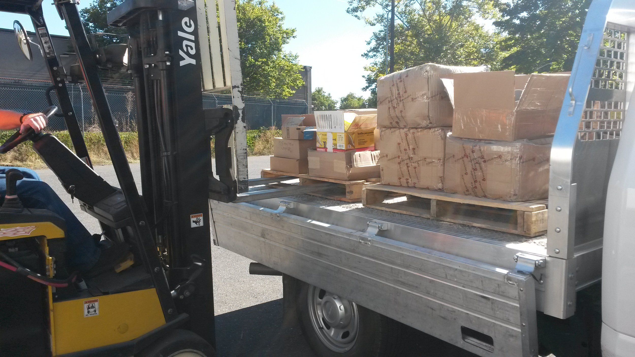The second load of stuff being forklifted off the truck.
