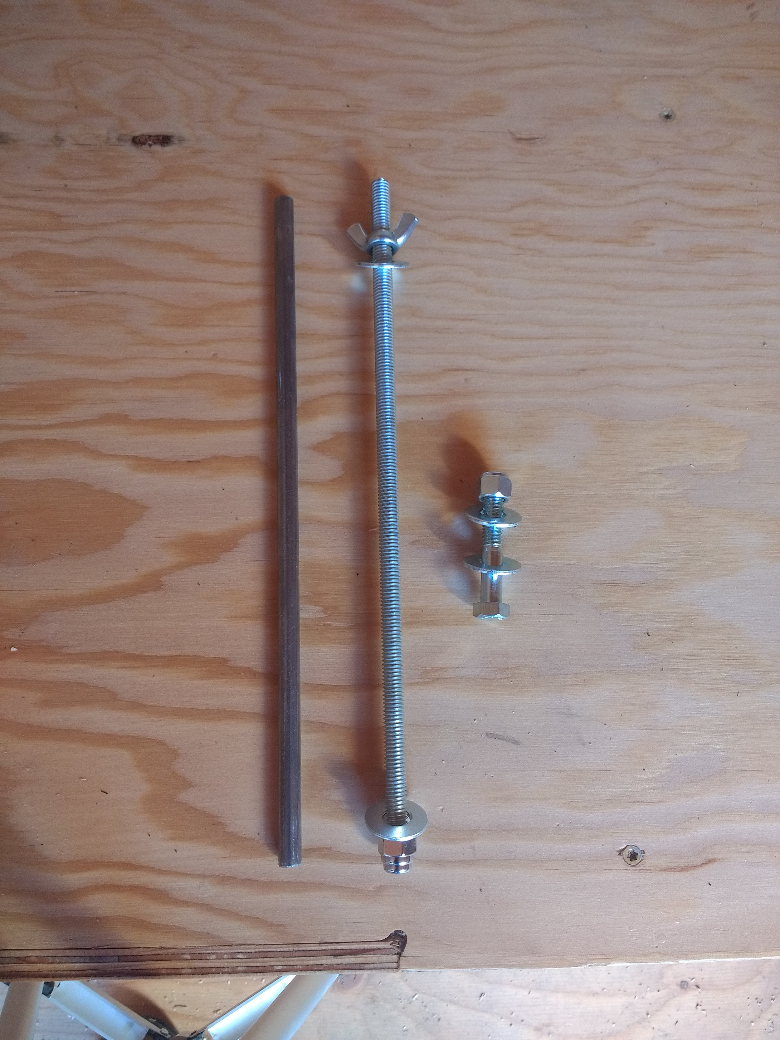 The steel pins, threaded rods, and final bolts we used to get the modules together