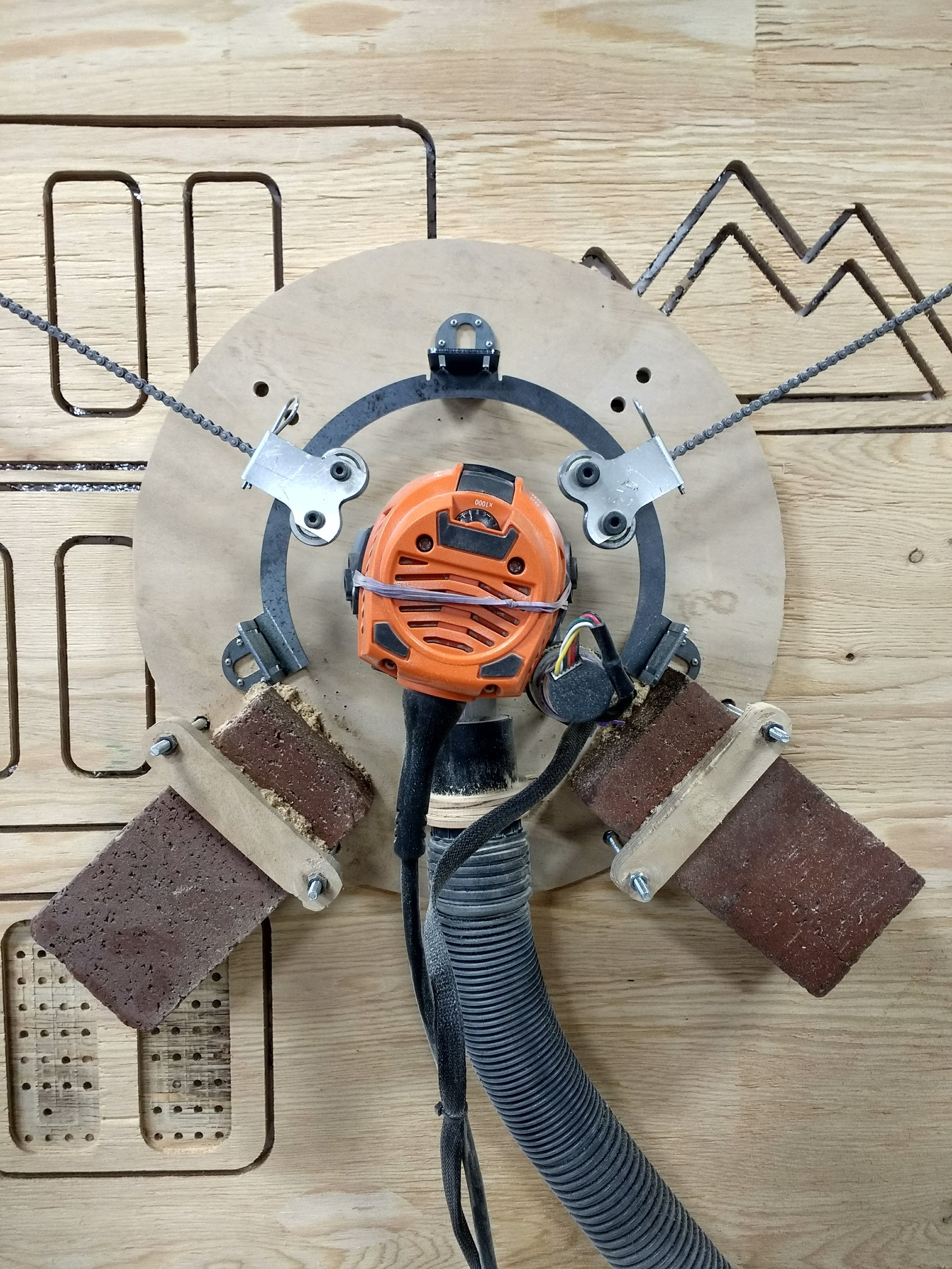 Our new ring system, where chains point to a single spot - the router bit.