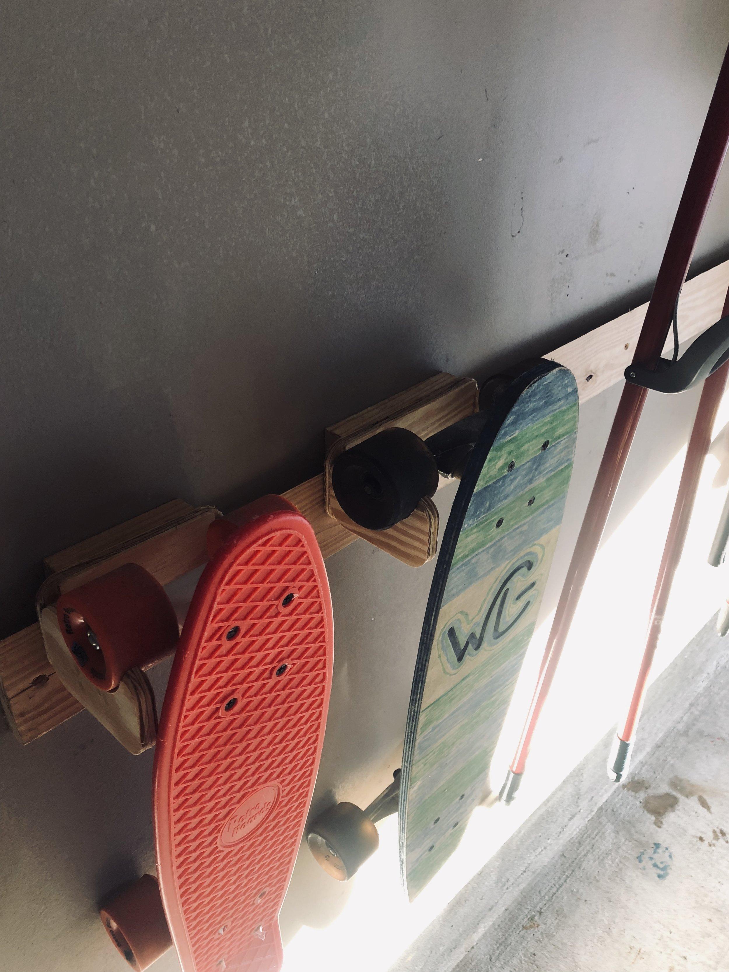 clintloggins skateboard holder.jpeg