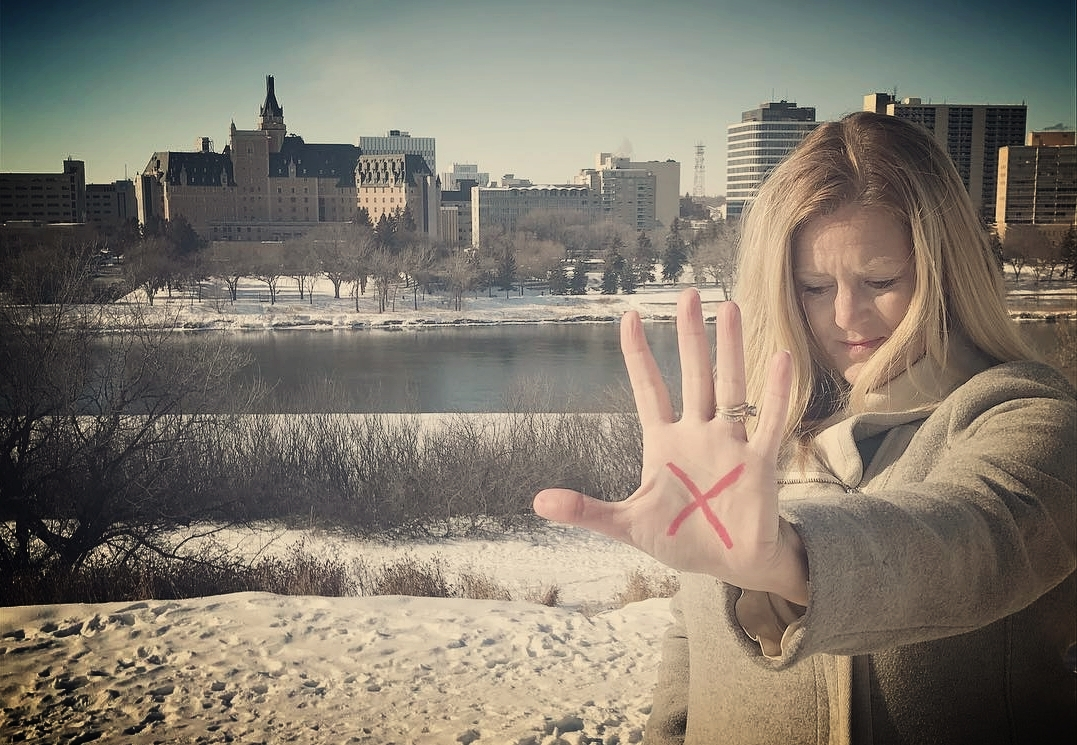 """Saskatoon is the host site for our first annual Summit. 1 week prior, HRC Leaders join the """"End it Movement"""" as hundreds post with a red """"x"""" on their hands declaring """"We're in it to end it""""."""