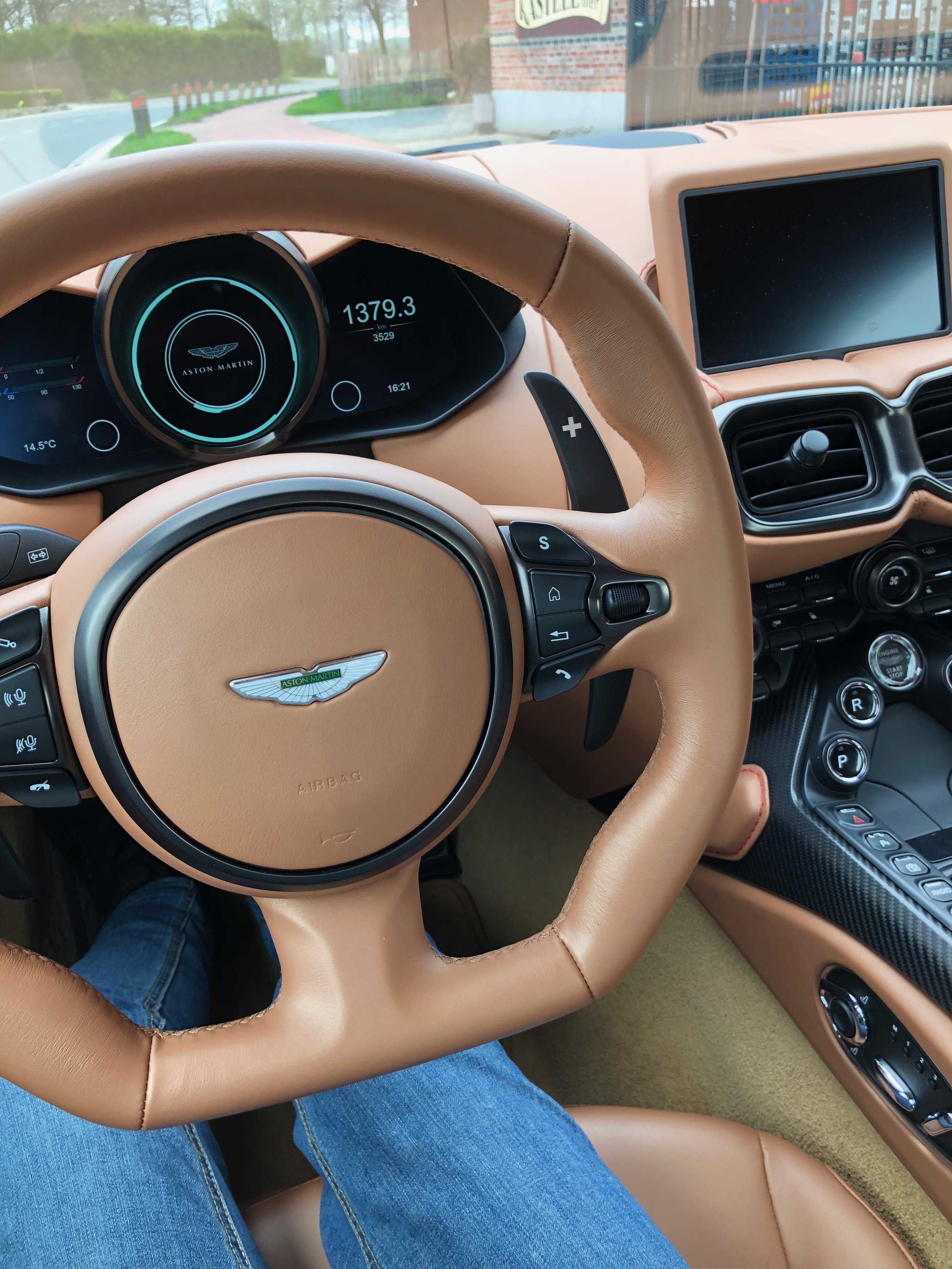 The interior of the Vantage is all beautiful leather