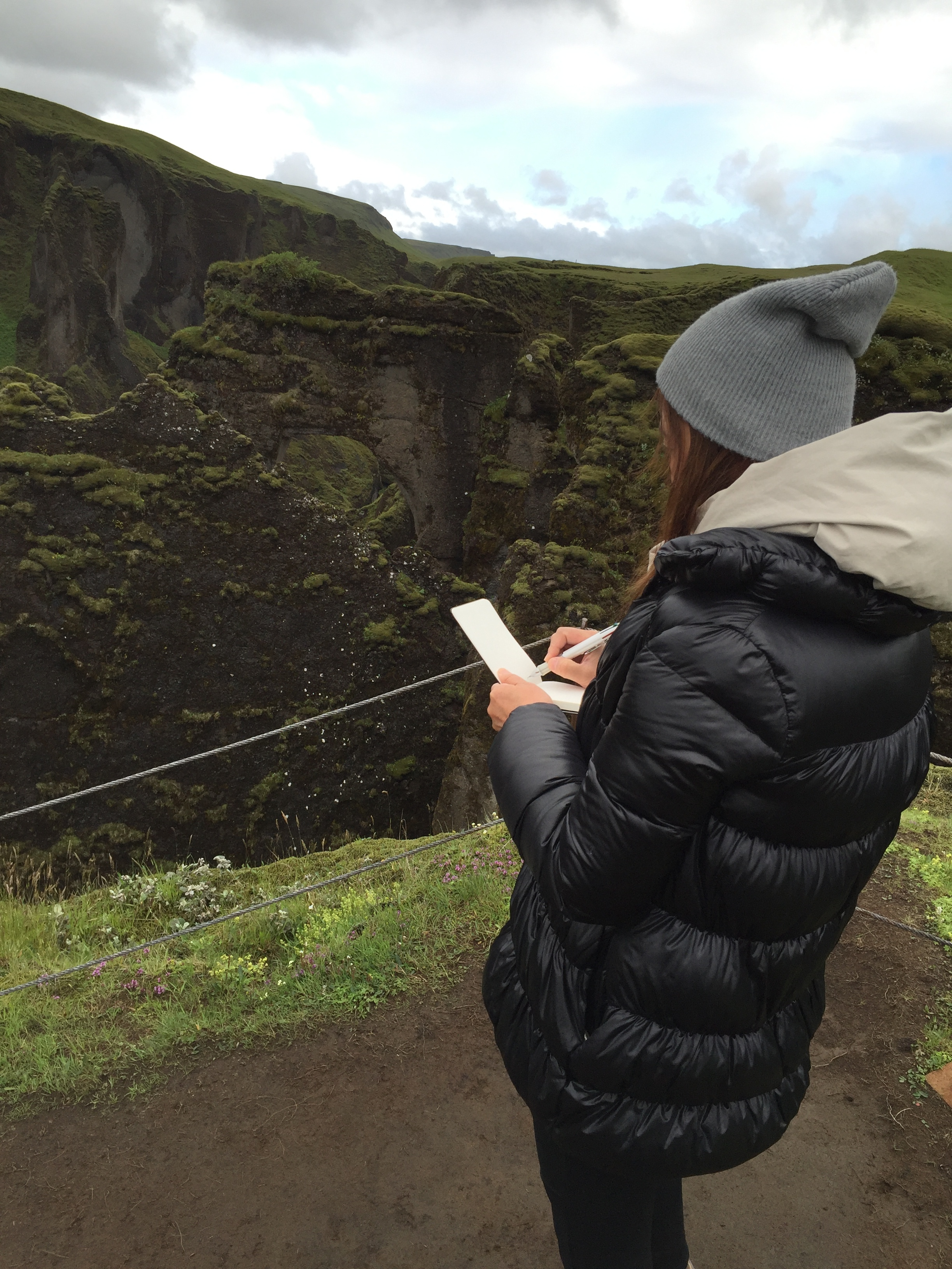 Artist drawing at Fjadrargljufur Canyon, Iceland
