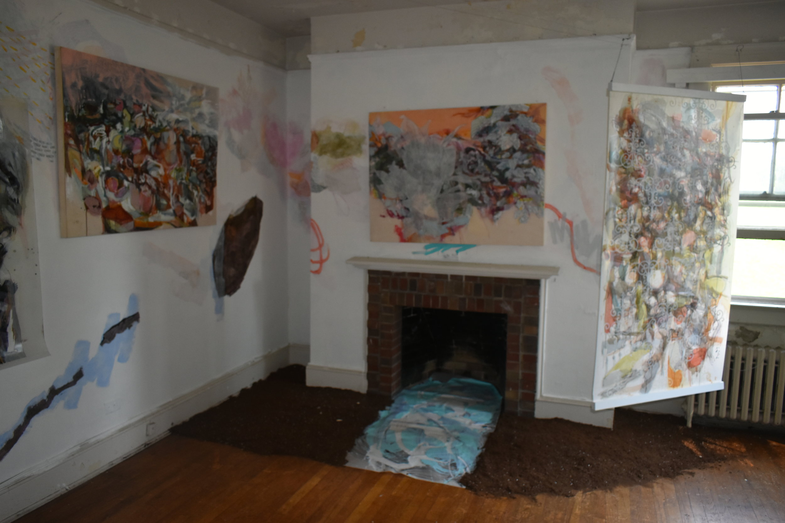 Installation scene on North and East walls with Murals and (water and soil elements) pieces on floor
