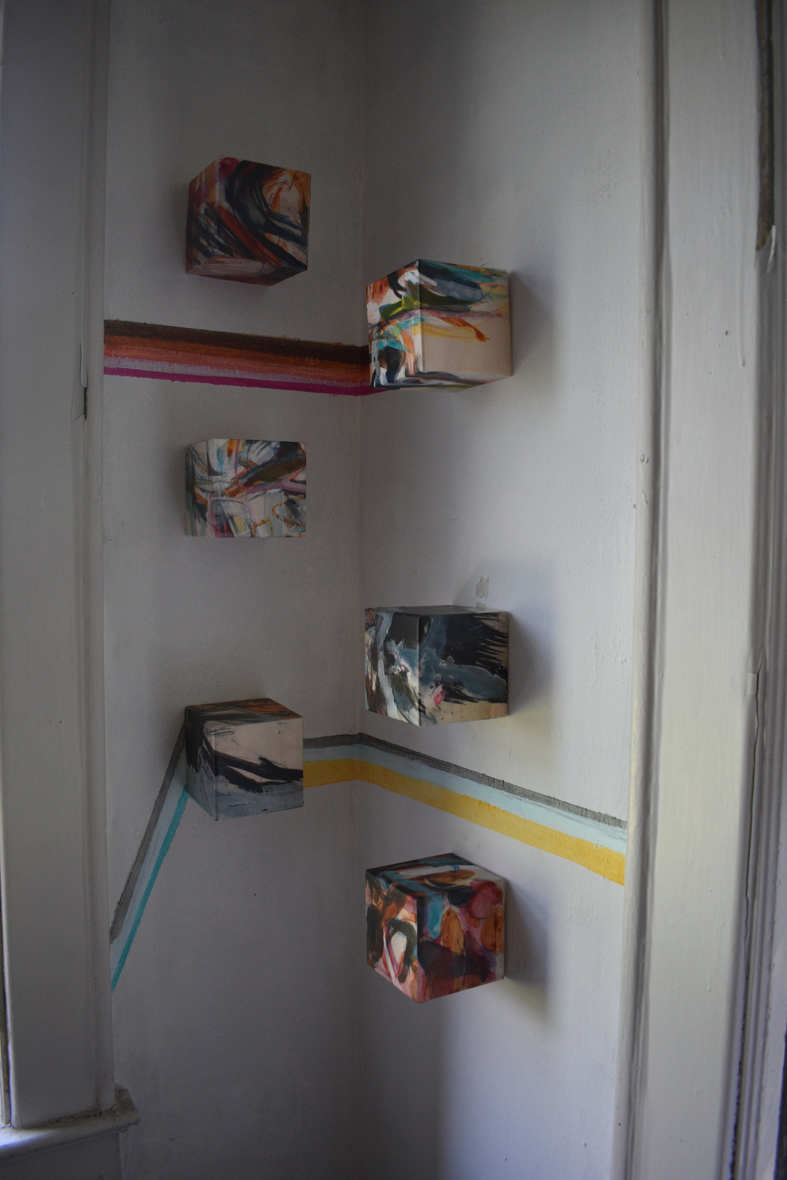 Faults Series (Soil element) on South East corner: Paintings on Mylar on Wood block 4.5 x 4.5 x 4.5 inch