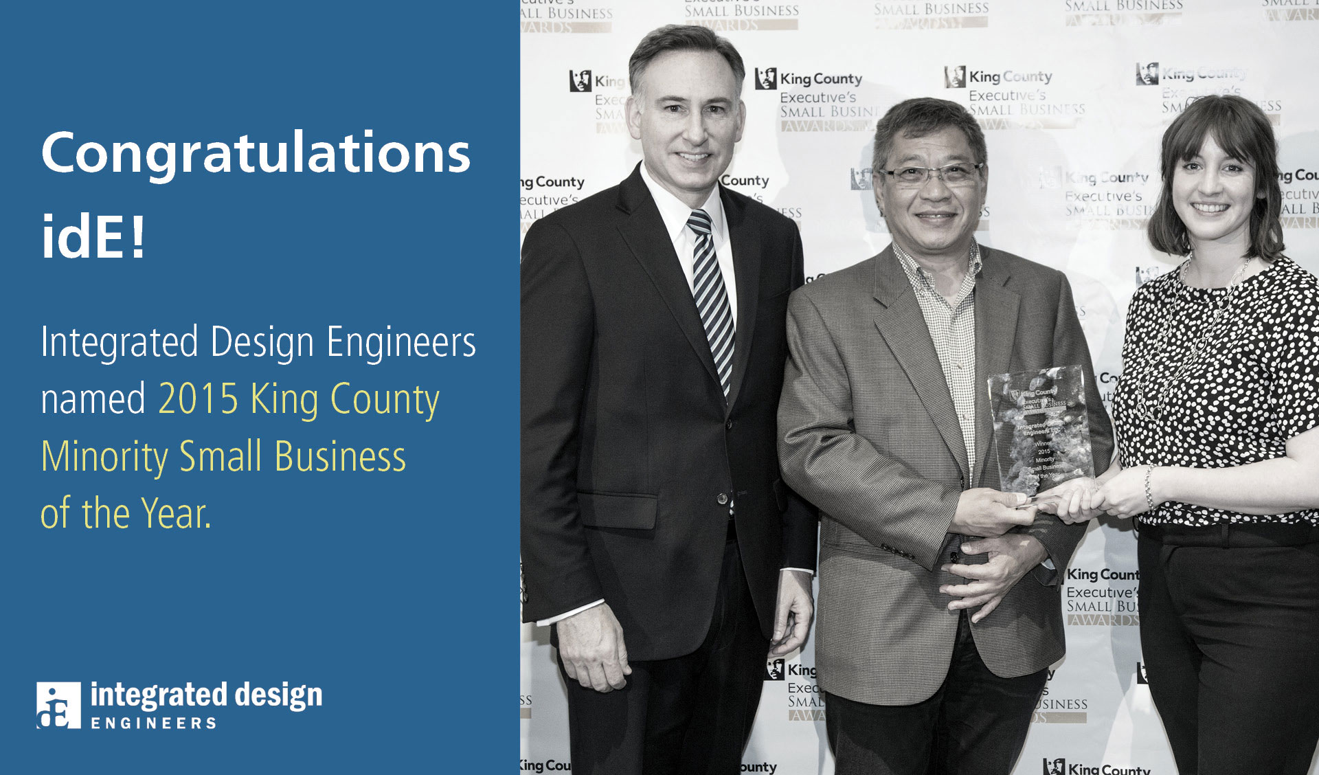 Integrated Design Engineers' Ignasius Seilie and Lindsey Burns accepts the award of King County Minority-Owned Business of the Year from King County Executive, Dow Constantine.
