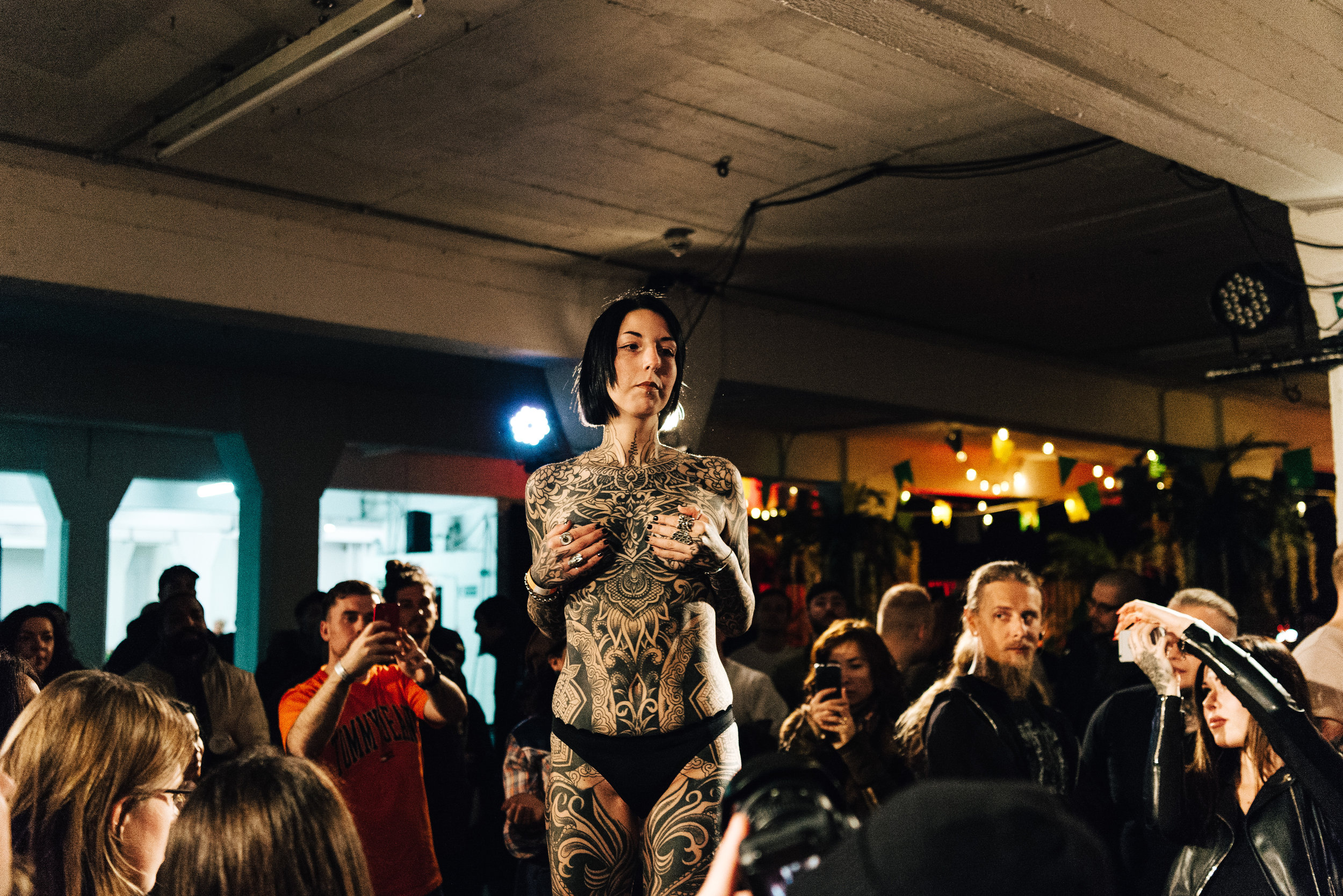 A woman presents her full-body tattoo during the Tattoo Collective competition at the Old Truman Brewery, Shoreditch on the 17th March 2018.