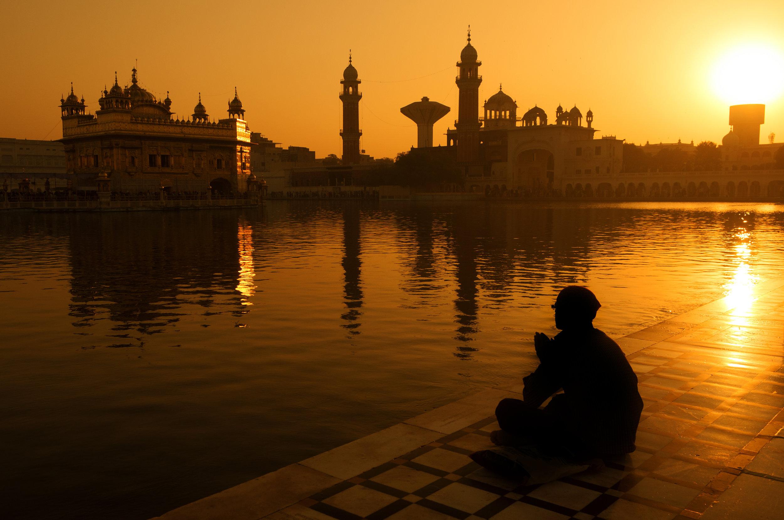 india_bigstock-Sikh-pilgrims-sitting-beside-t-108772307.jpg