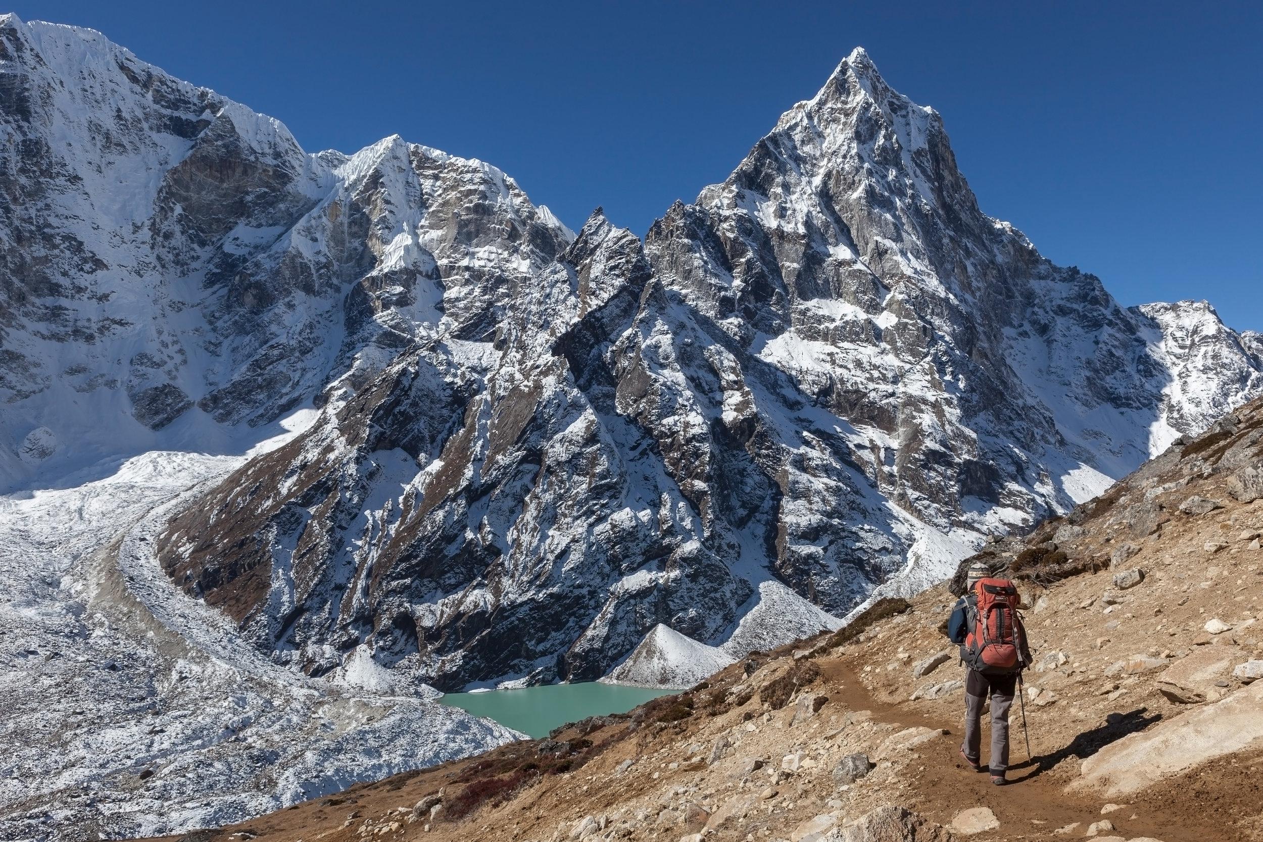 nepal_bigstock-Active-Hiker-Trekking-In-Nepal-186325393.jpg