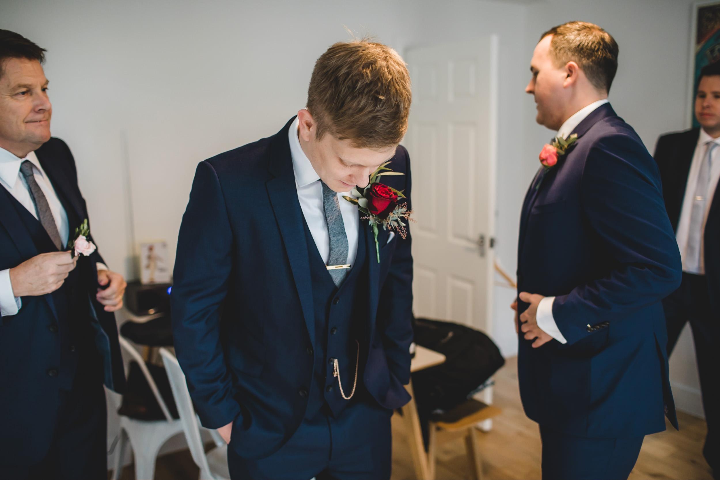 groom waits nervously for wedding