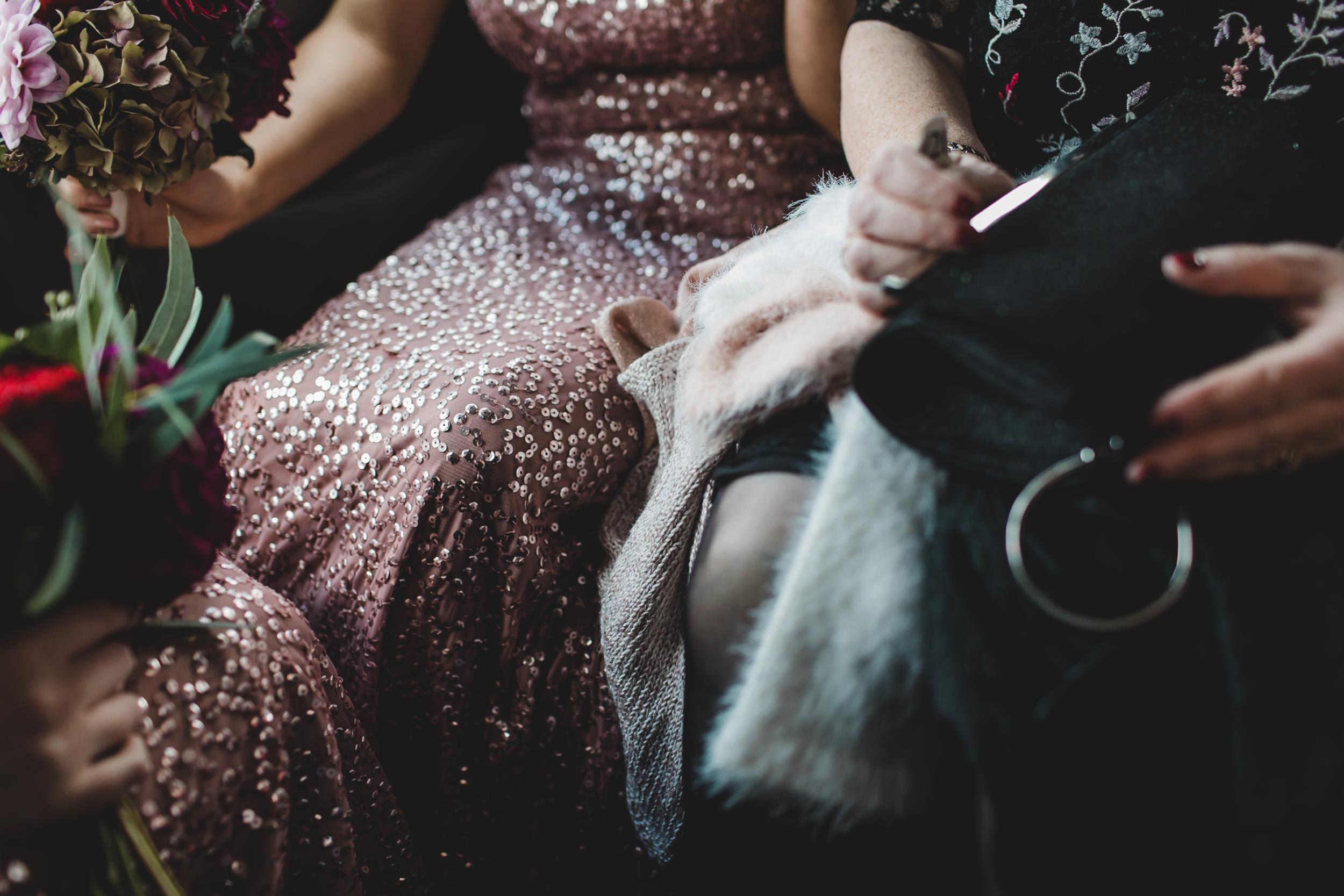 bridesmaids in taxi cab