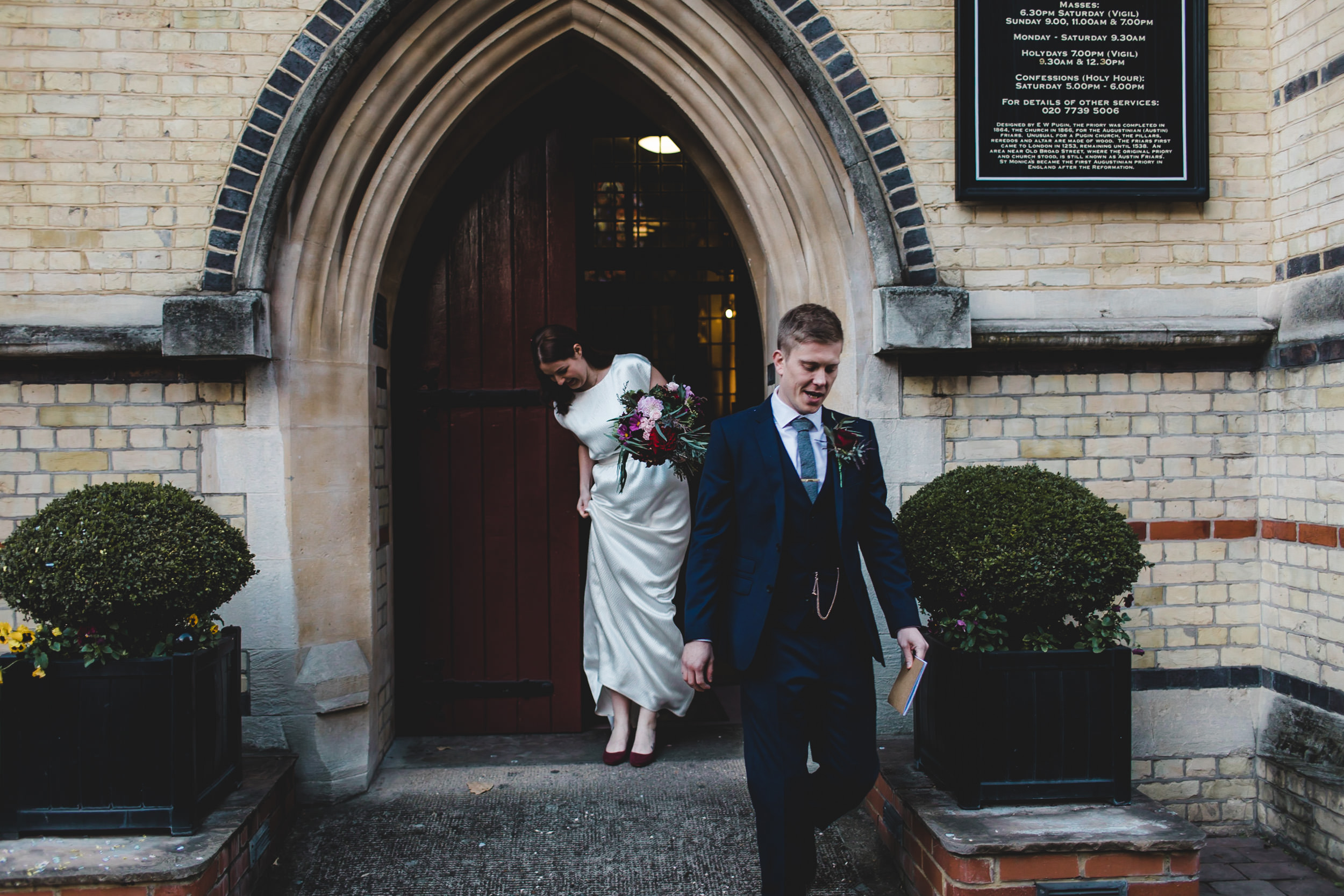 bride and groom leave st monicas church