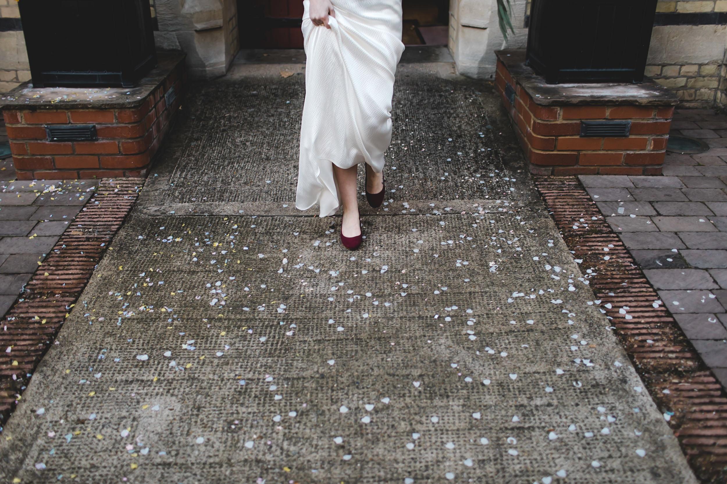 bride walks through confetti on floor