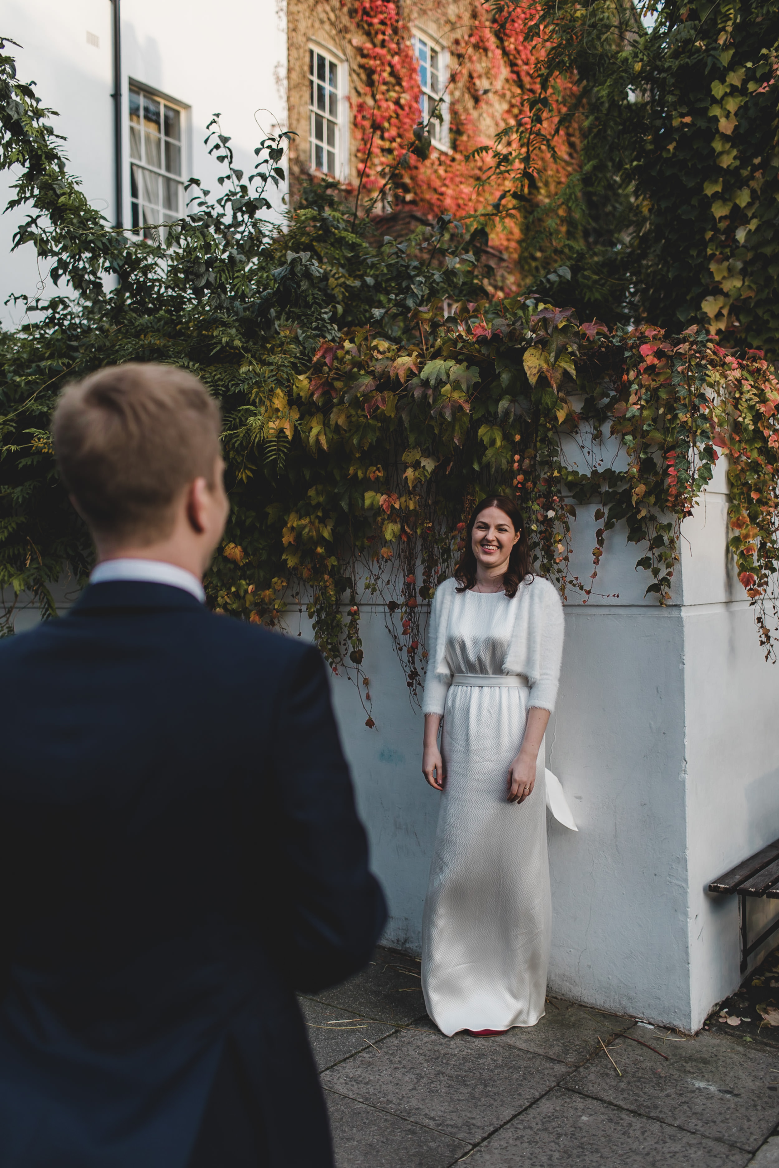 bride and groom and autumn foliage