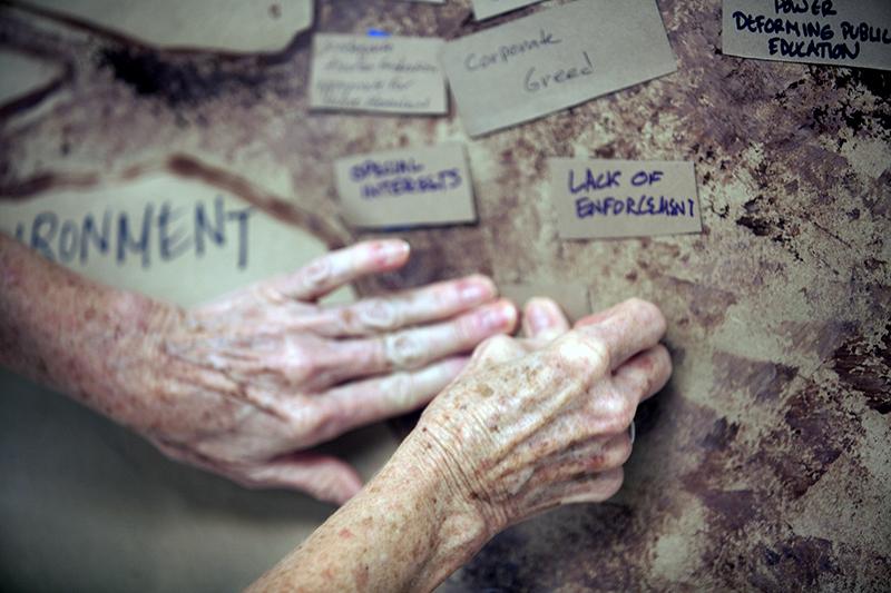 Elder Hands placing Trunk oahu IF.jpg