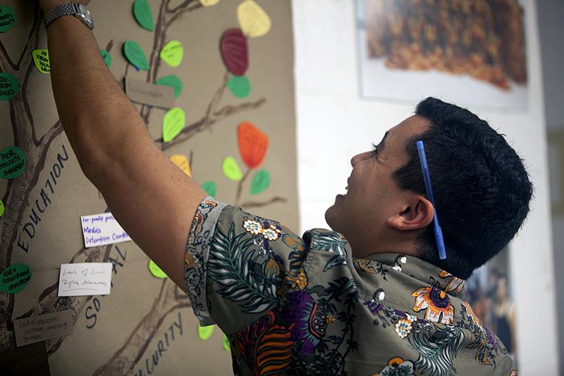 Smiling man adorning tree oahu IF.jpg