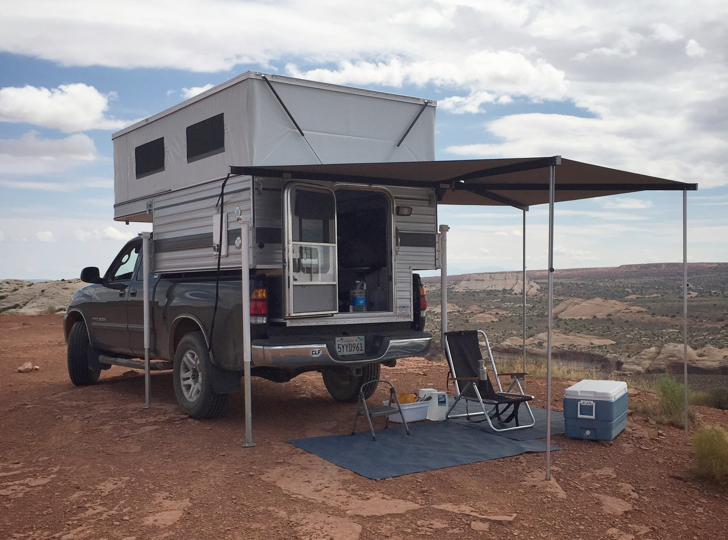 After a lot of research I settled on this setup for my mobile studio. A pop-up camper is dry, secure, heated, powered, very comfortable and puts no limits on where a pick-up truck can go.