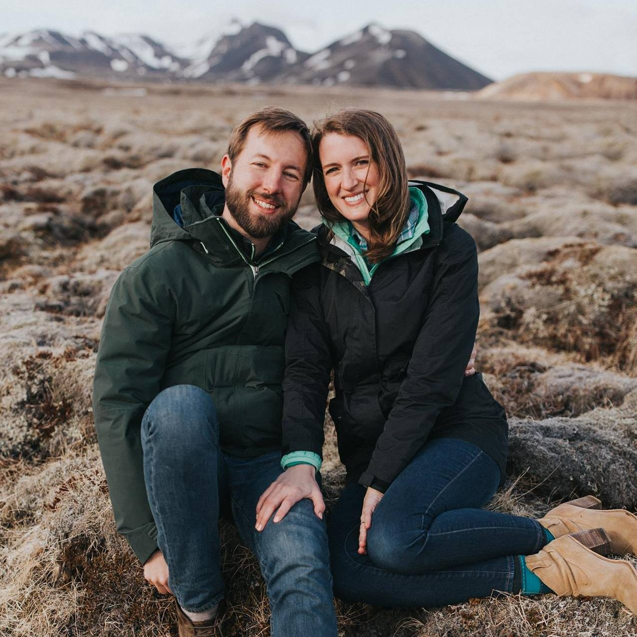"""We met up with Rachel in Iceland for a multi-day """"adventure"""" engagement session, which included traversing mossy lava fields, exploring black sand beaches, and wading through a stream to find a hidden waterfall. The conditions were crazy unpredictable -- often time freezing cold with big gusts of wind and mist -- but Rachel found a way to capture some really AMAZING photos that we love. I was a little nervous before our session, since I'm not one to take many photos of myself and haven't had professional photos in ages, but Rachel is so much fun to work with and really makes you feel comfortable (yes, even in the rain and cold). We are returning to Iceland for our wedding next summer and are of course bringing her along for the ride! I would recommend Brasspenny Photography to anyone looking for a professional and FUN photographer.   - Alison and Dan"""