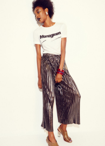 Come closer. Anything but basic white t-shirt plus metallic wide leg pleated pants.