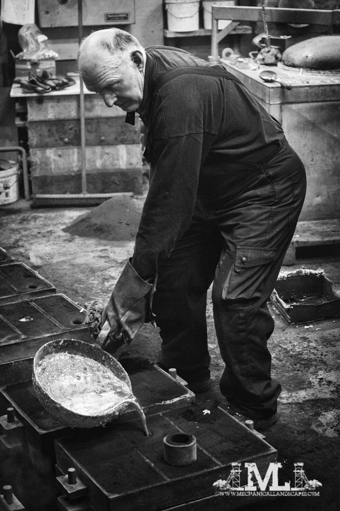 Pouring the molten aluminium into the moulds.