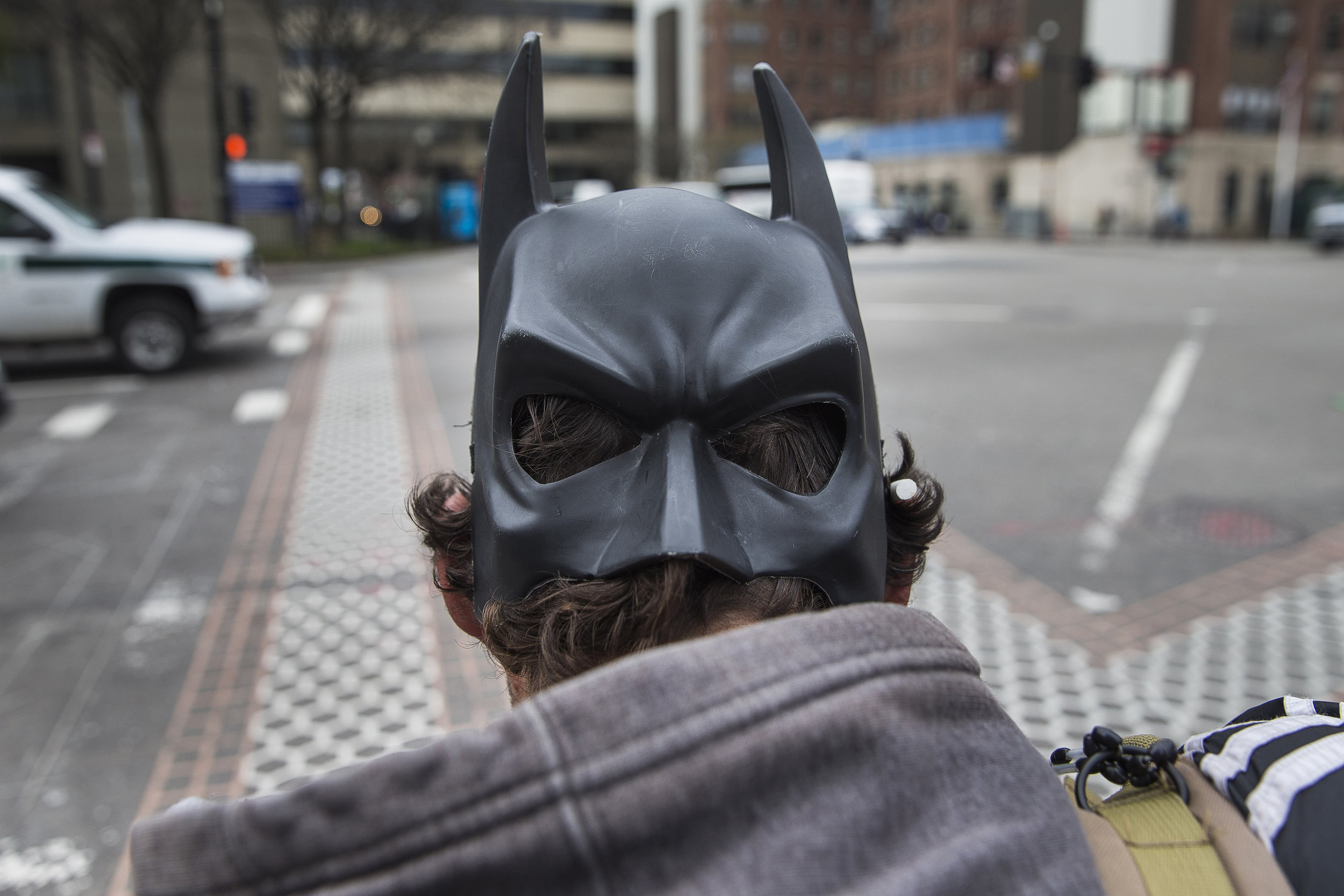 "Leonardo Parente wears a Batman mask as he walks along a stretch of Massachusetts Avenue. ""I want to be able to kick this and eventually work here. I'm not asking for a free check, I'm not asking for SSI or any of that.  I'm asking for a job and a place to live and to be part of society here, and that's what I'm striving for."""