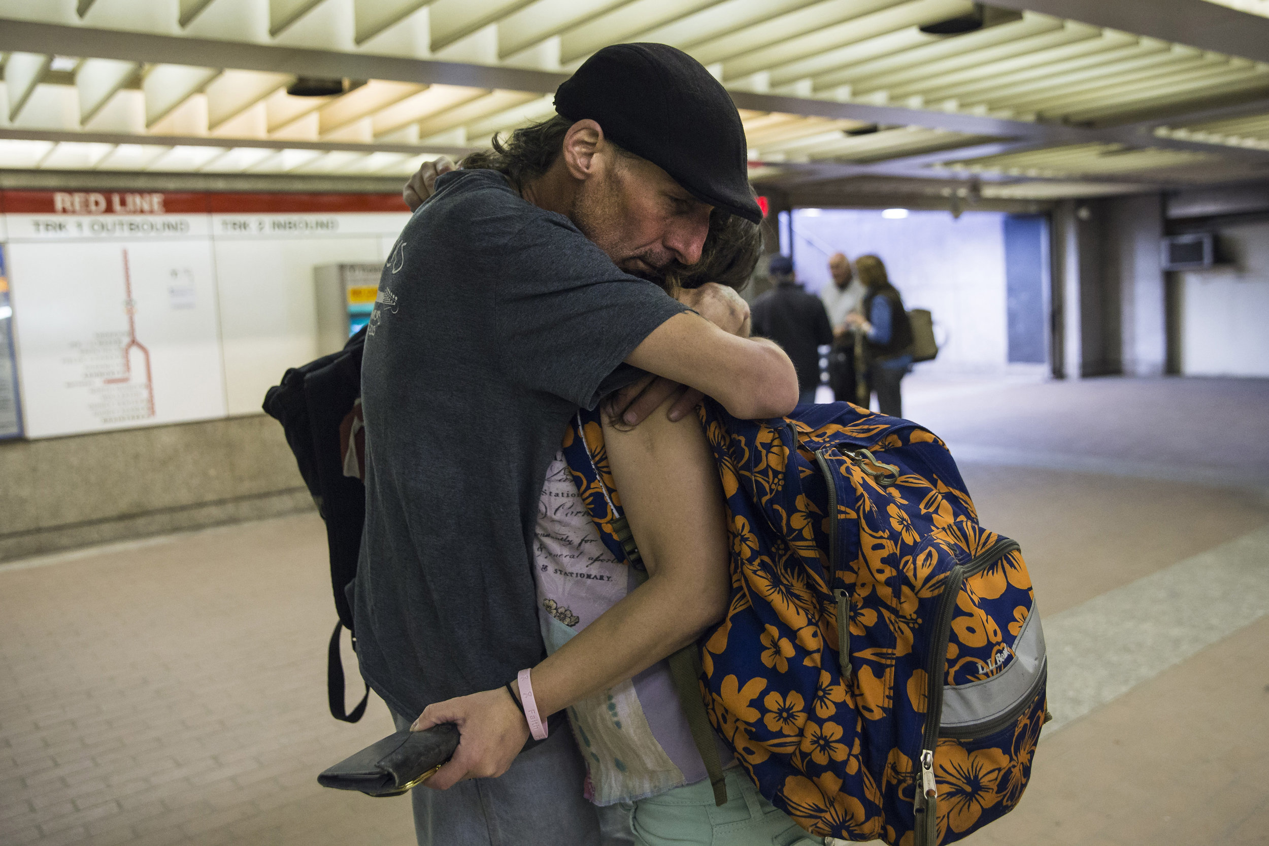 "Shaun ""BoneZ"" LeBlanc hugs his wife Donna Perry goodbye as she gets on the subway for a job interview. While Donna has been sober and in a women's shelter for nearly three months, Shaun still uses daily and lives on the streets as there are no shelters that offer a place for couples to stay together."