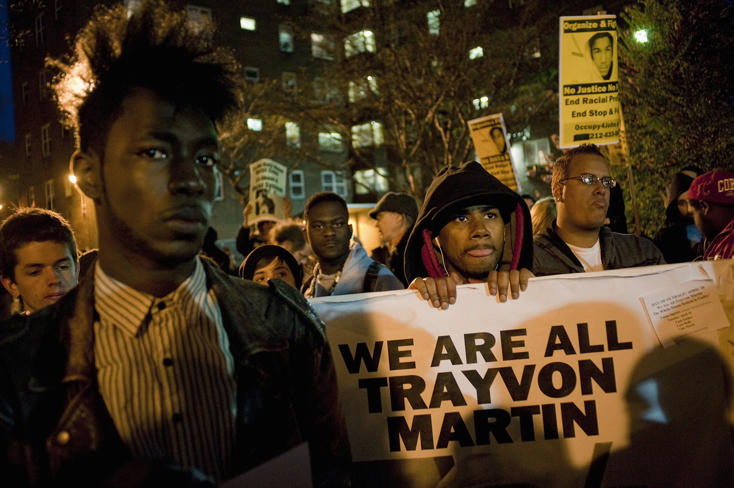 Demonstrators march in a rally in support of slain teenager Trayvon Martin in New York April 10, 2012. The February 26 killing of the black teenager by neighborhood watch captain George Zimmerman, a Hispanic man, has triggered protests around the country.