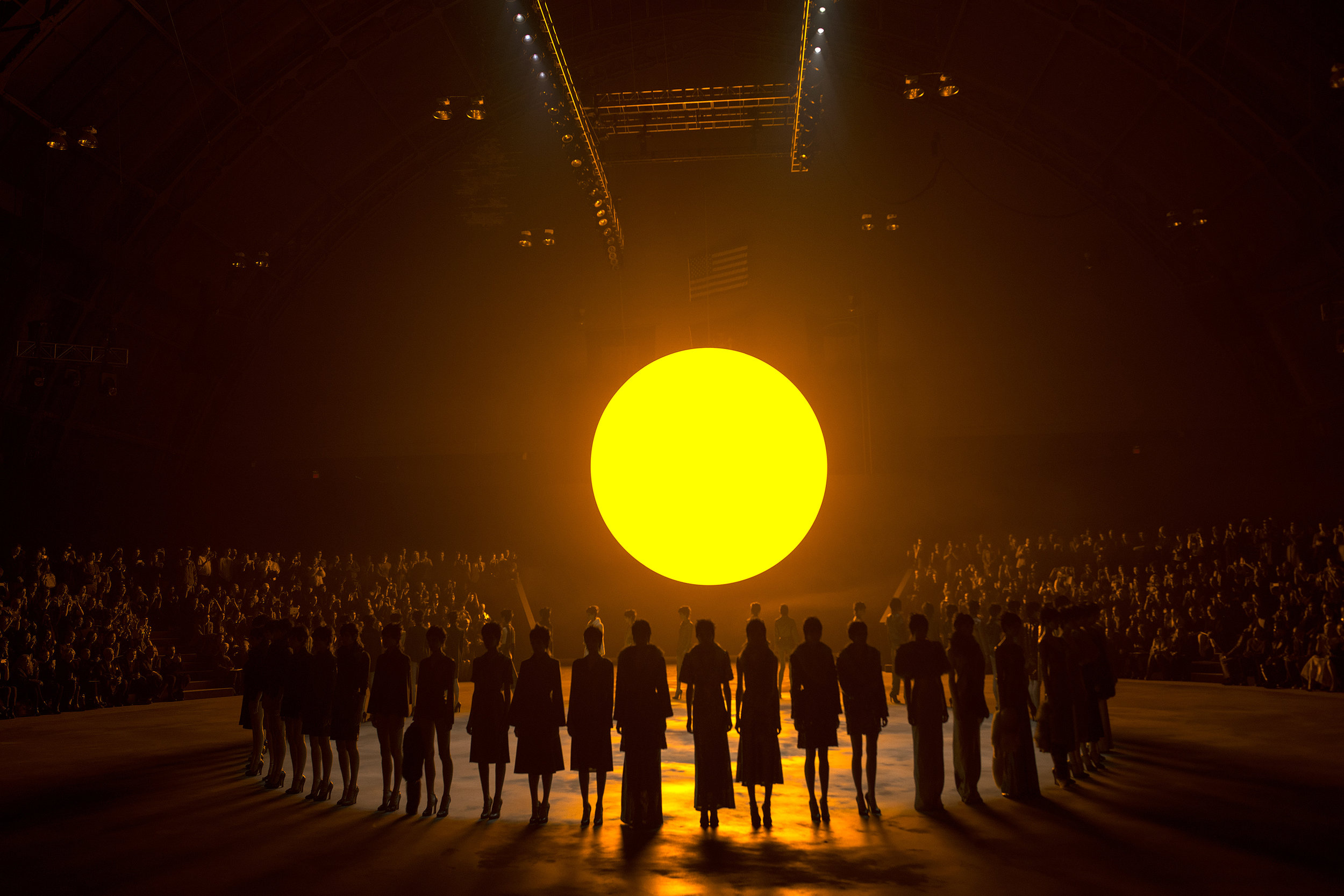 Models present creations from the  Marc Jacobs Autumn/Winter 2013 collection under the glow of an artificial sun during New York Fashion Week.