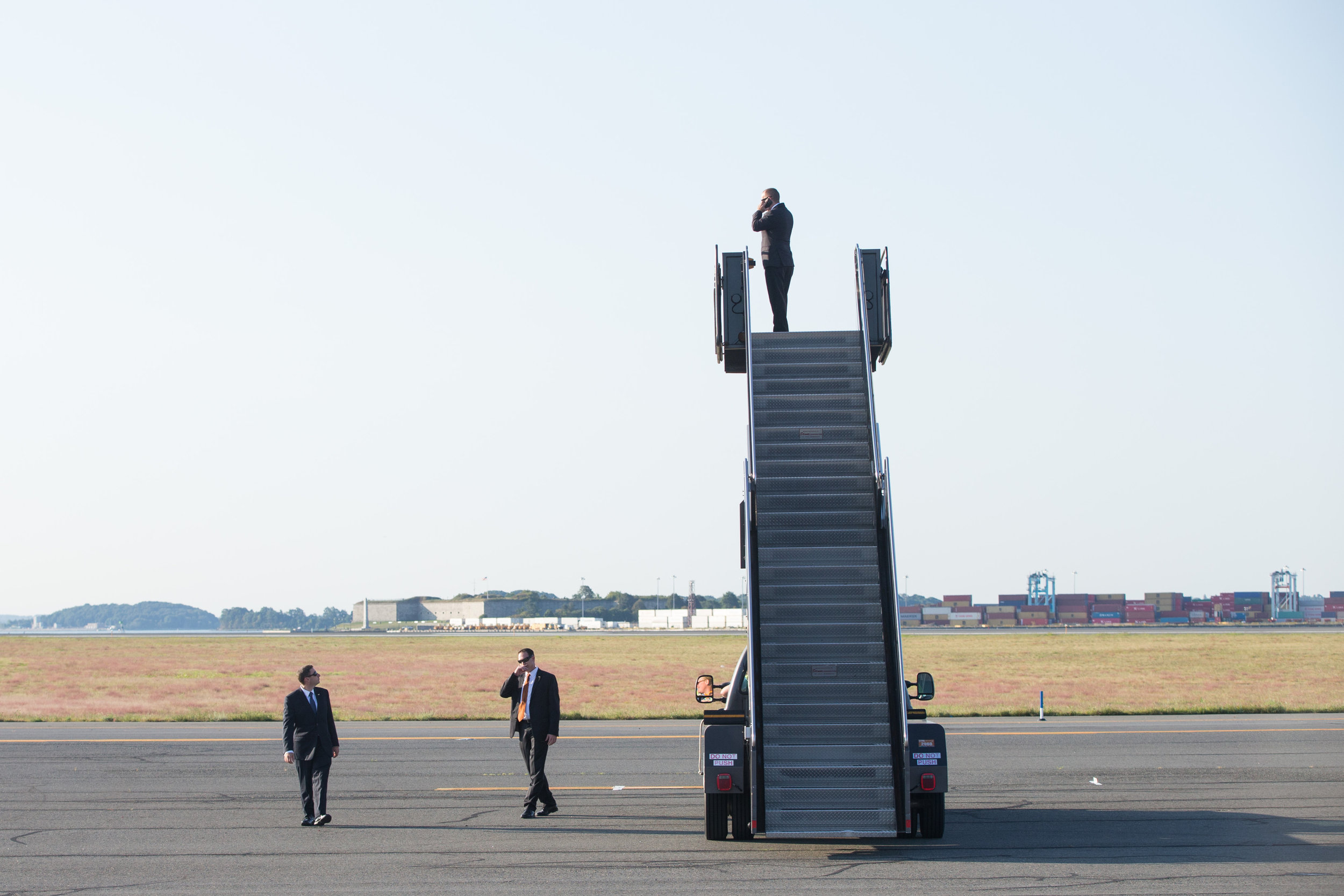 Secret Service agents prepare of the arrival of U.S. President Barack Obama at Logan International Airport in Boston, Massachusetts, September 7, 2015.