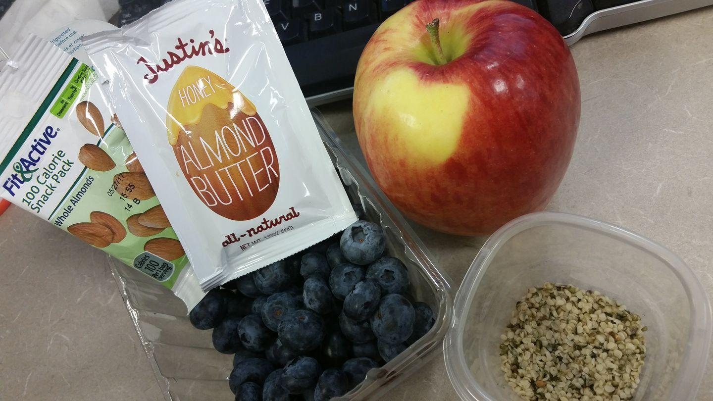 Almonds, almond butter w/ honey, blueberries, apple, hemp hearts.
