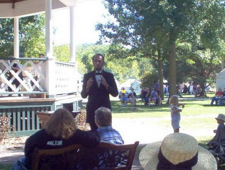 Speaking at the Gazebo, Usher's Ferry Village, Cedar Rapids, IA   lancepresentsabe.com