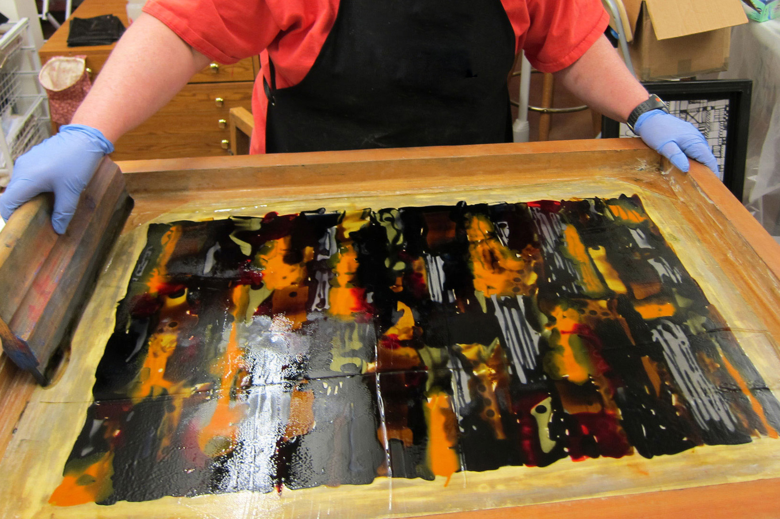 Learning silkscreen techniques in our artist workshop in Napa Valley California. Art Travel Workshop students can select from many artistic disciplines
