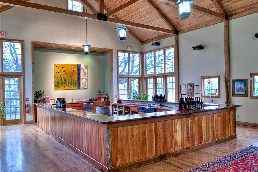 Tasting room with large scale wine chemistry and landscape artwork by Taylor Smith