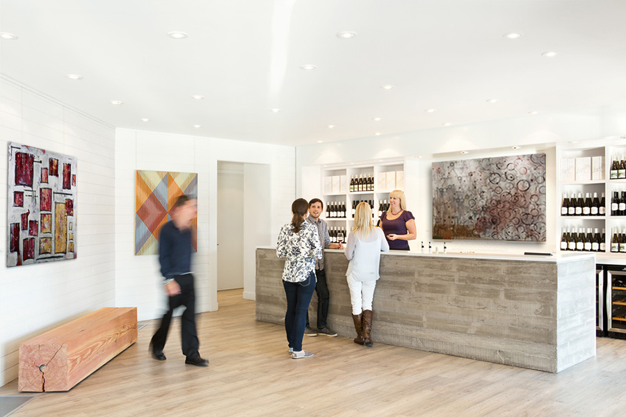 Winery guests enjoy the contemporary artwork in the tasting room