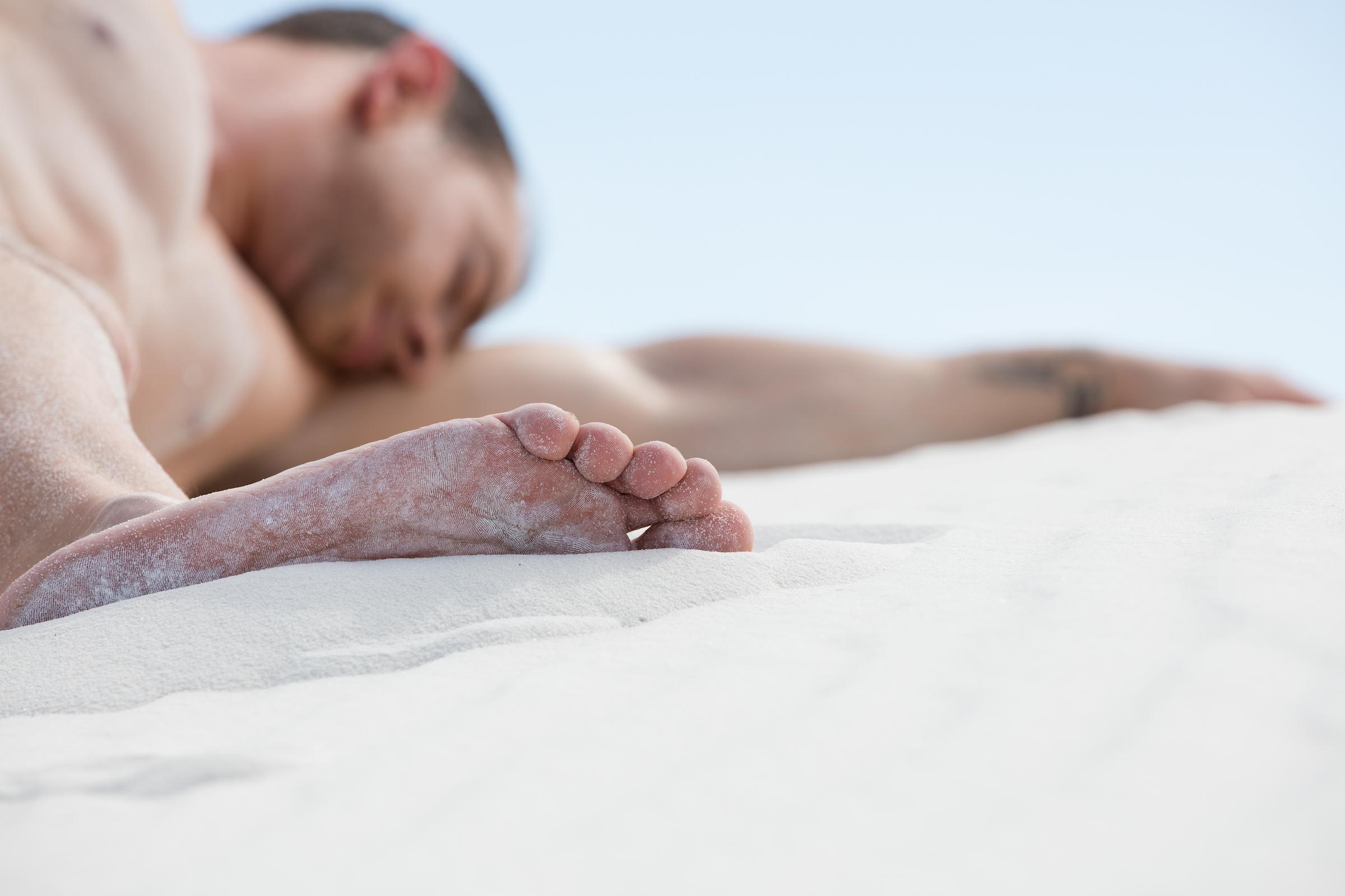 man-sleeping-in-sand.jpg