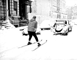 Skier towed by vintage auto in city.jpg