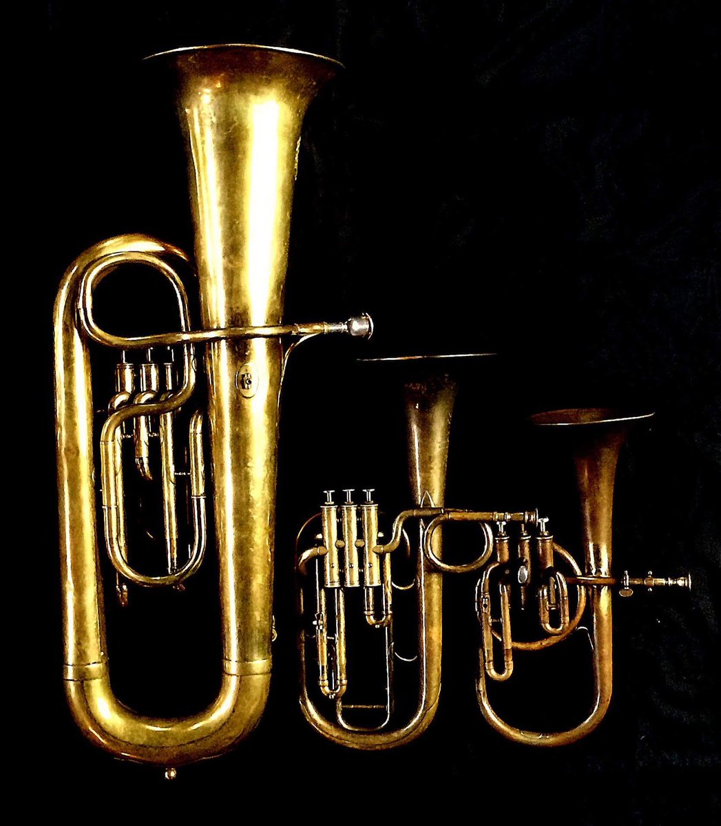 Left to Right:  Contrabass saxhorn     in E flat by E. Daniel (7167, Marseille, c. 1850),   Tenor saxhorn in F/E flat/D   by Antoine Courtois (Paris, c. 1855), sold by Arthur Chappell (London) ,  Contralto saxhorn in B-flat   by J. Grass (32 Rue des Ponts de Comines, Lille, est. 1868.