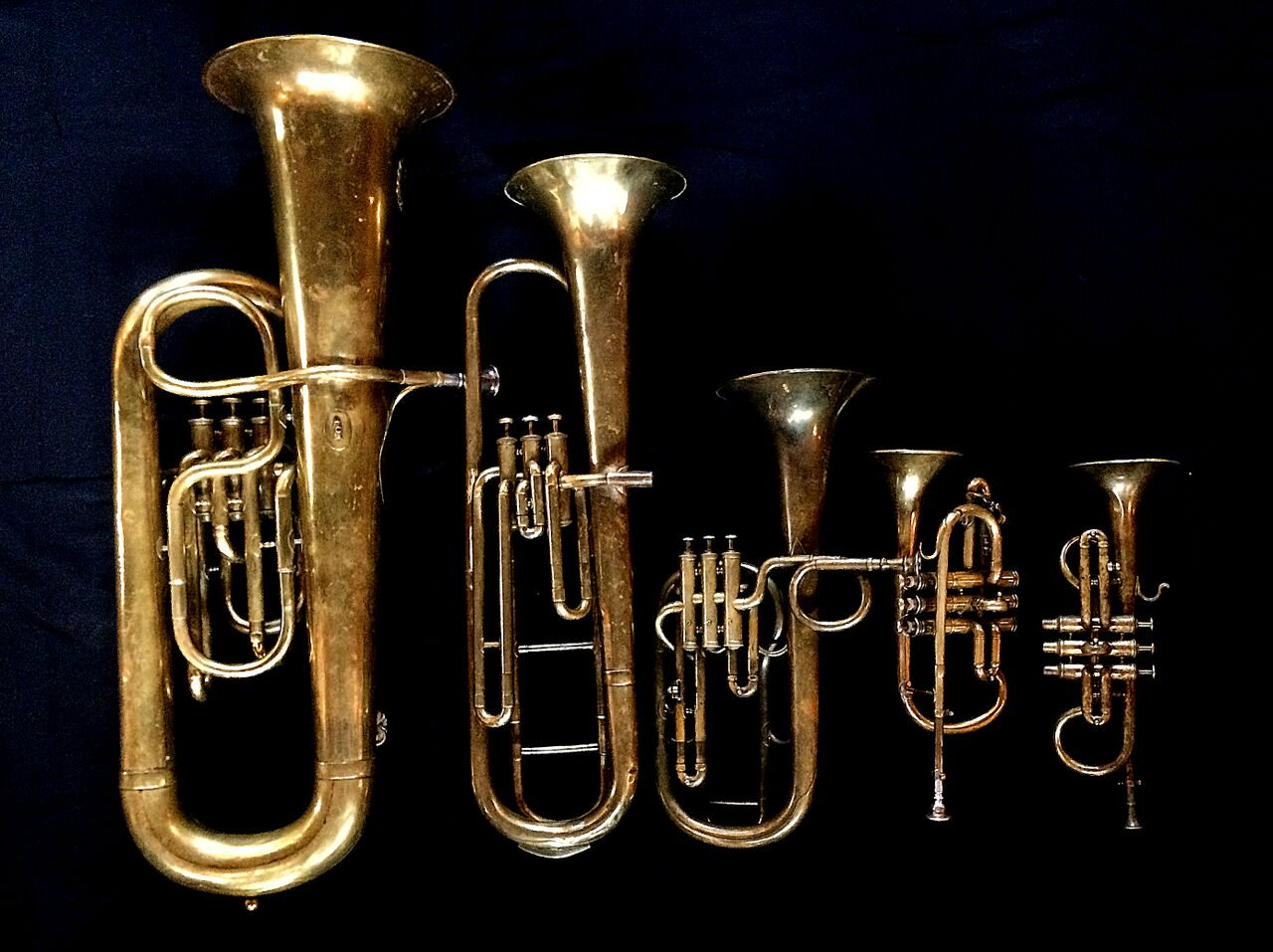 Left to Right:  Contrabass saxhorn in E-flat   by E. Daniel (7167, Marseille, c. 1850),   Baritone saxhorn in C/B flat   by Couturier (Lyon, c. 1865),   Tenor saxhorn in F/E flat/D   by Antoine Courtois (Paris, c. 1855), sold by Arthur Chappell (London)  ,   Cornet in E-flat   by Couesnon   (94 Rue D'angouleme Exposition Universelle De Paris 1900),   Cornet in E-flat     by  Henry Distin (Gt. Newport Street, London, c. 1851-1868),.