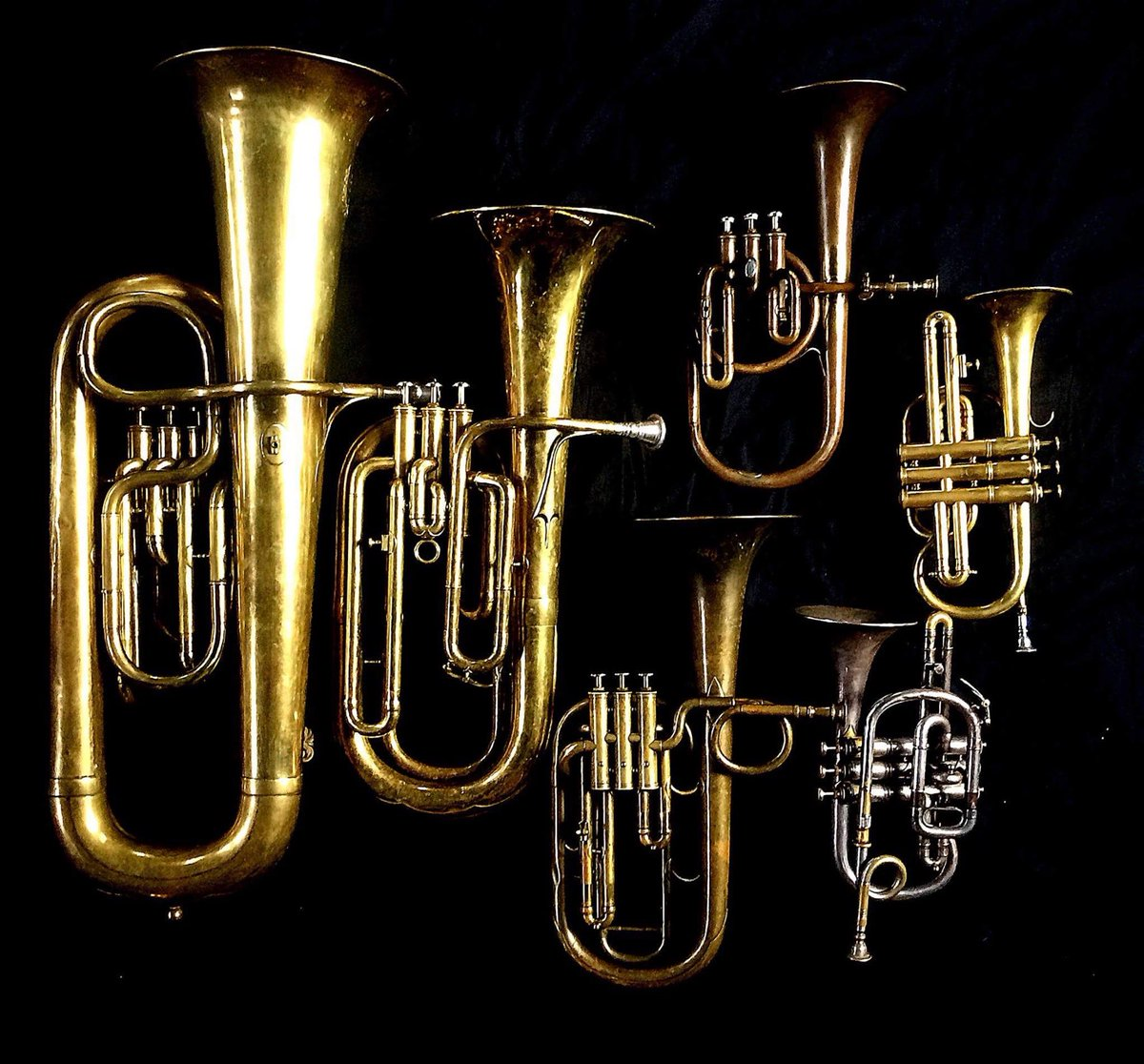 Left to Right:   Contrabass saxhorn in E-flat   by E. Daniel (7167, Marseille, c. 1850),     Baritone saxhorn in B-flat     by Couesnon (44139, 94 Rue D'angouleme Exposition Universelle De Paris, 1900)  ,     Tenor saxhorn in F/E flat/D     by Antoine Courtois (Paris, c. 1855), sold by Arthur Chappell (London),        Contralto saxhorn in B-flat     by J. Grass (32 Rue des Ponts de Comines, Lille, est. 1868.,   Cornet in C/B-flat     by Henry Distin New American Model (9580, Williamsport, PA, c. 1895) ,  Cornet in B-flat/A   by F. Besson (44292, 96 Rue D'angouleme, Paris c. 1892).
