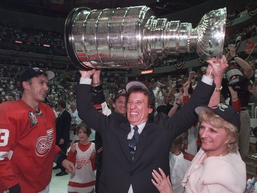 Mike Ilitch hoists the Stanley Cup in 1998. Photo by Julian H. Gonzalez, Detroit Free Press