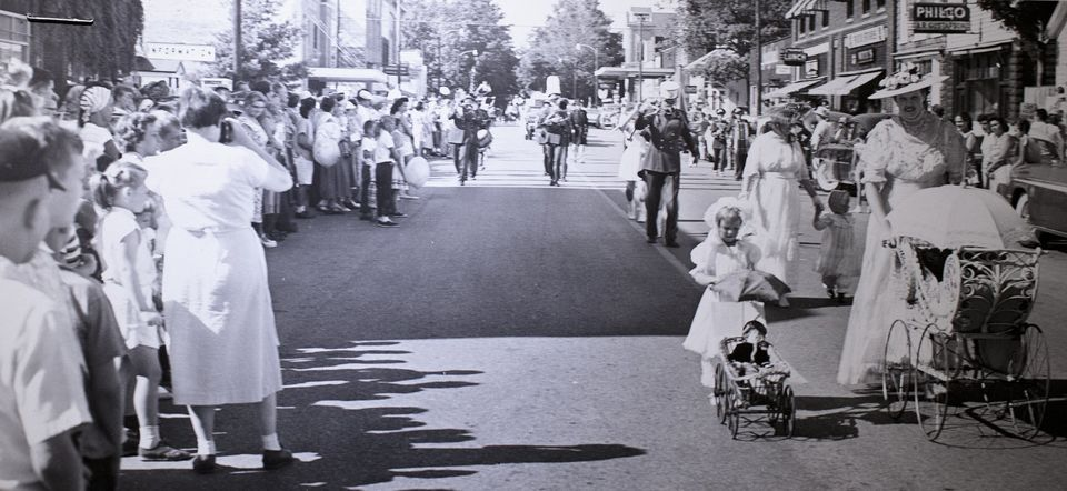 Downtown Pentwater during a parade in August of 1957, photo via Muskegon Chronicle