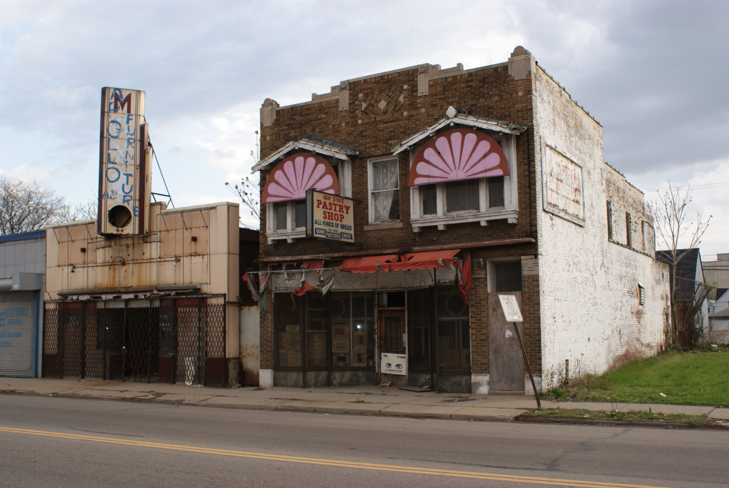 (Left) Apollo Furniture Store sits empty in the old Max's location, (right) Van Dyke Pastry Shop after it was left abandoned. Photograph taken pre-arson in May of 2008 by Robert Monaghan.  SOURCE