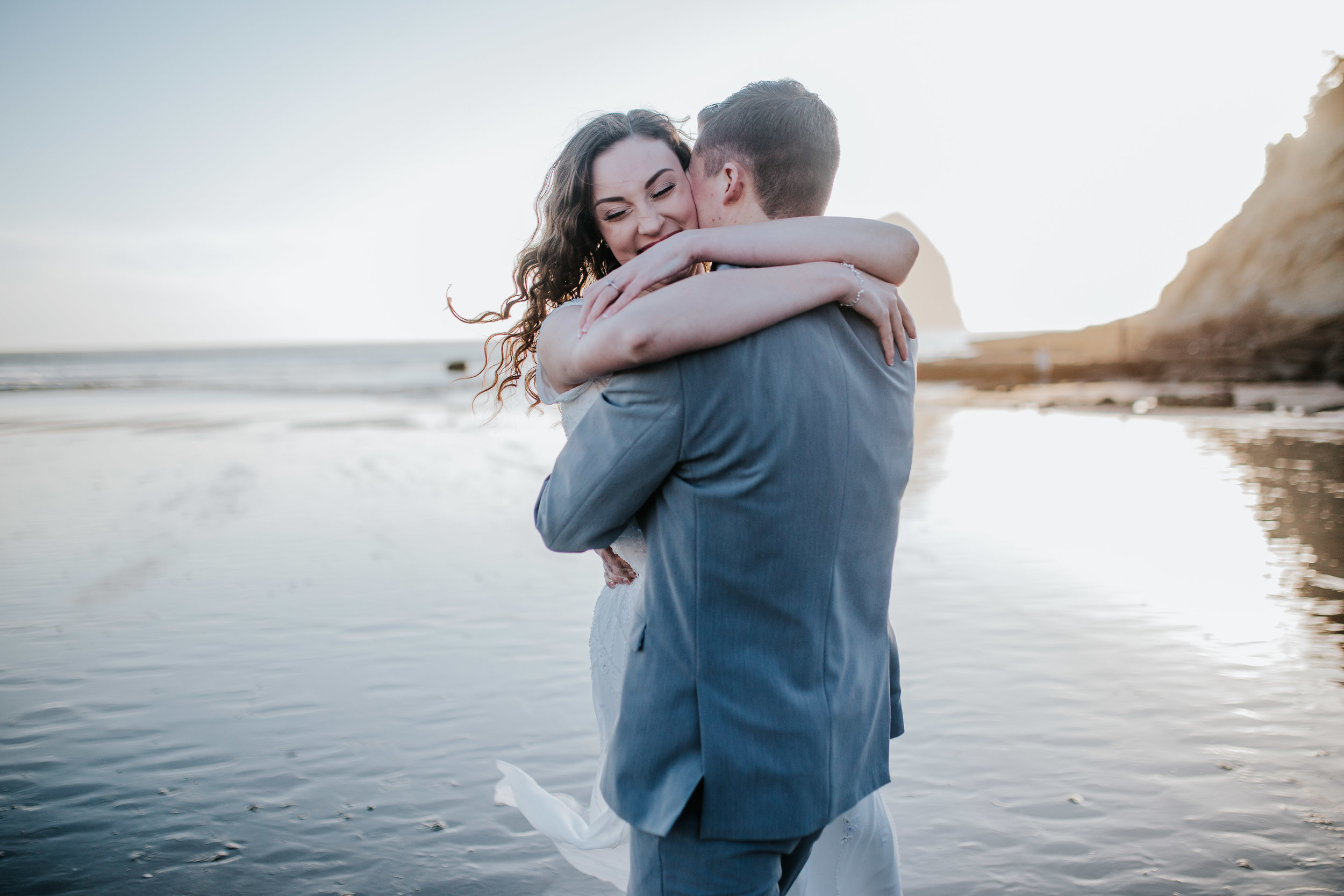Cannon and Pacific Beach Oregon Wedding Session Groom Spins Bride around on beach